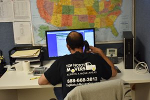 Tom on the phone, providing our clients with a moving quote