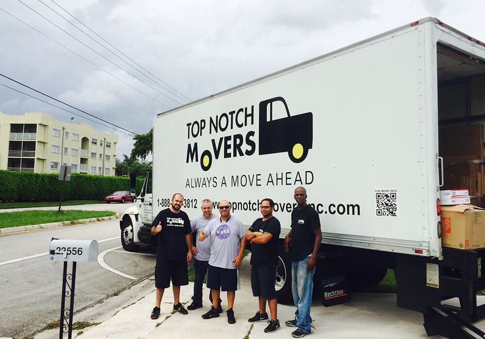 Boynton Beach movers in front of Top Notch Movers truck