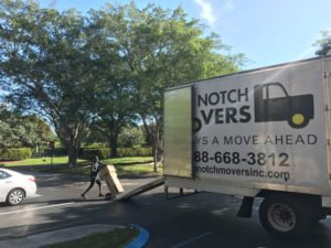 Aventura Mover loading Top Notch Movers truck