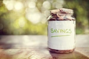 Savings in the jar full of coins, moving economically can be beneficial