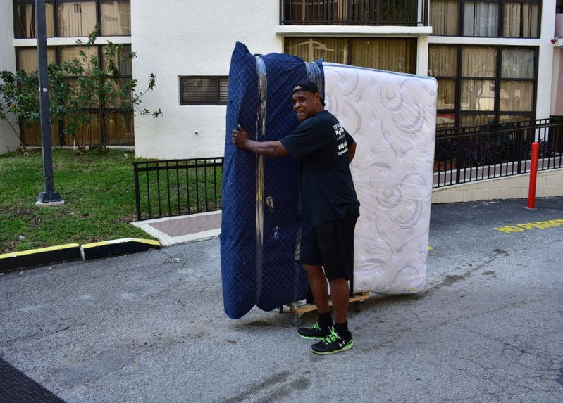 Antonio handling mattress during our local moving services