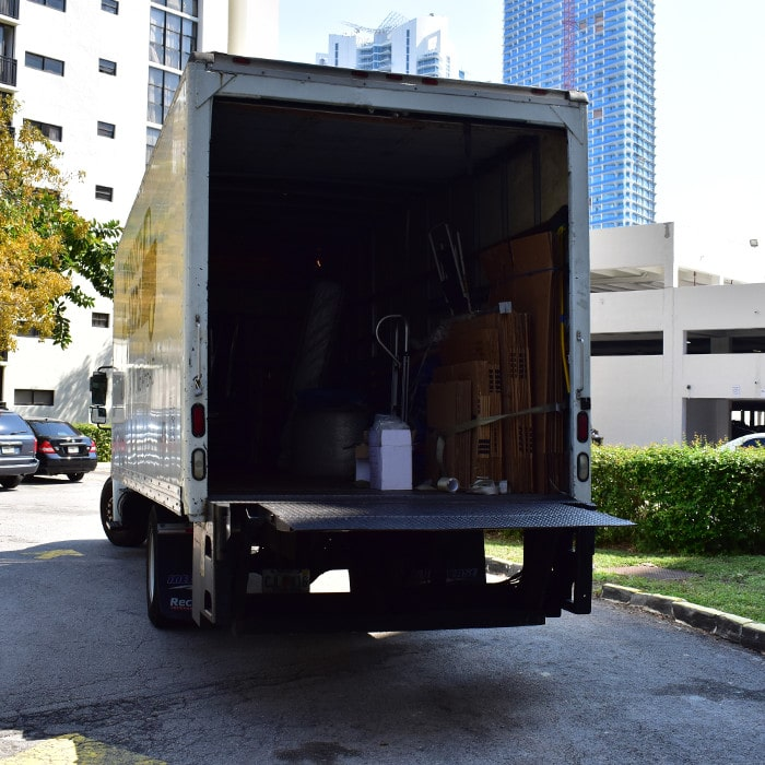 Miami dade movers - loading goods to CT - Sunny Isles
