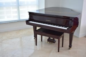 Baby grand piano, dark brown, before piano movers arrive