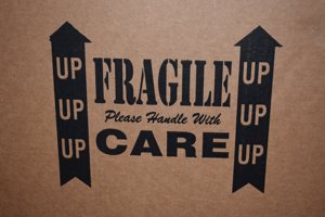 Wording on the box, fragile please handle with care