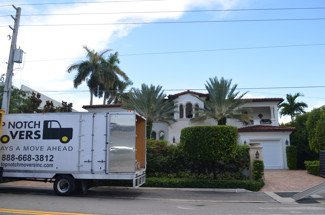 Our truck parked in front of the building, Fort Lauderdale Beach.