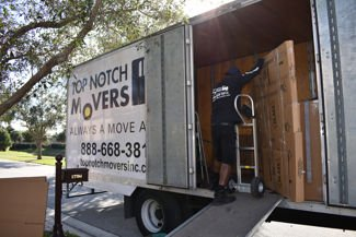 Sam moving a dresser, Fort Lauderdale condo move.