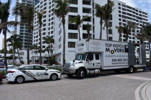 Top Notch Movers truck and a car in Hallandale, FL